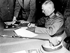 'Field Marshall Wilhelm Keitel, signing the ratified surrender' by Marion Doss